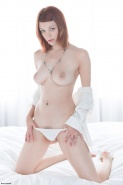 Gorgeous soft and sexy redhead Bree Daniels masturbating on the bed from X-Art Beauties