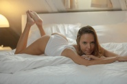 Sexy petite erotic babe Clover posing on bed from X-Art Beauties